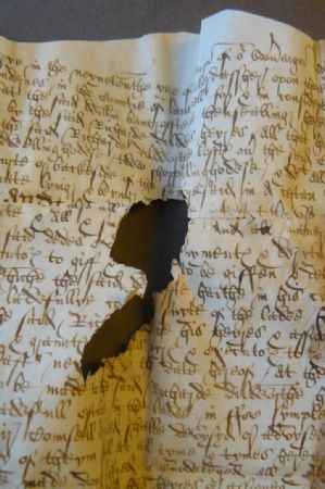This is an imaged parchment document from Yarburgh Muniments Lancashire Deeds YM. D. Lancs Jan. 13-14, 1576/7. -  By permission of The Borthwick Institute for Archives'.